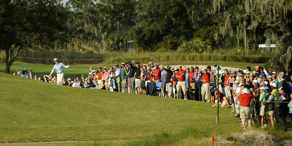 Photo - Briny Baird hits out of the bunker on the 18th fairway during the final round of the McGladrey Classic golf tournament on Sunday, Nov. 10, 2013, in St. Simons Island, Ga. (AP Photo/Stephen Morton)