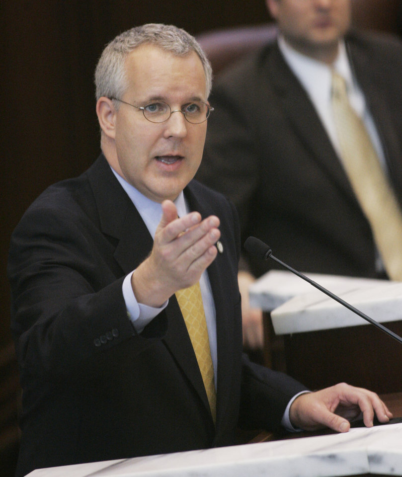 Photo - GOVERNOR: Oklahoma Gov. Brad Henry gestures as he speaks to a joint session of the Legislature in Oklahoma City, Monday, Feb. 4, 2008. Henry asked lawmakers to write