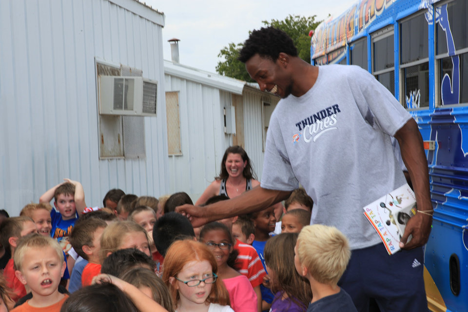 Oklahoma City Thunder center Hasheem Thabeet appears at Houchin Elementary School in Moore for Rolling Thunder Book Bus appearance on Sept. 7, 2012. After three unproductive NBA seasons, Thabeet has landed in Oklahoma City with hopes of earning the backup center spot. Photo provided by the Oklahoma City Thunder.