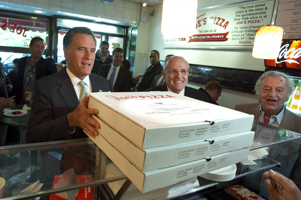 Photo -   Republican presidential candidate, former Massachusetts Gov. Mitt Romney, accompanied by former New York City Mayor Rudy Giuliani, picks up pizza for firefighters in New York, Tuesday, May 1, 2012. (AP Photo/Jae C. Hong)
