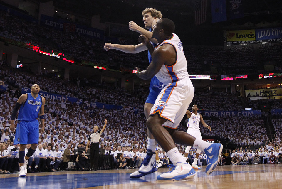 Photo - Oklahoma City's Kendrick Perkins (5) is pushed by Dallas' Dirk Nowitzki during Game 2 of the first round in the NBA basketball playoffs between the Oklahoma City Thunder and the Dallas Mavericks at Chesapeake Energy Arena in Oklahoma City, Monday, April 30, 2012. Photo by Sarah Phipps, The Oklahoman