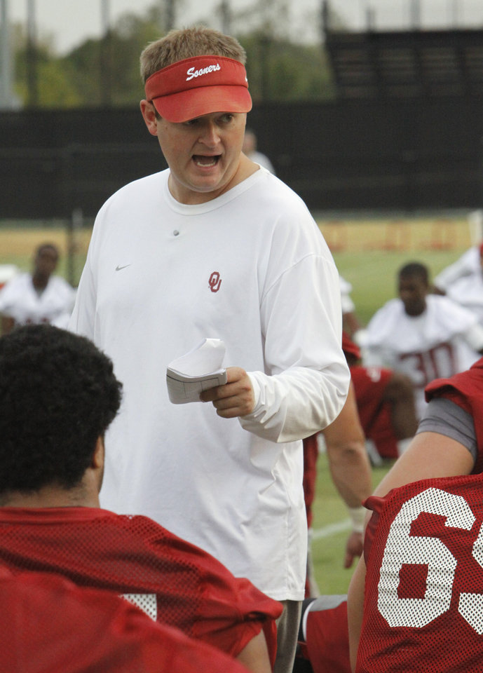Photo - Co-Offensive coordinator Josh Heupel talks to his offensive line during the University of Oklahoma (OU) Sooners first day of practice on Thursday, August 4, 2011, in Norman, Okla.   Photo by Steve Sisney, The Oklahoman