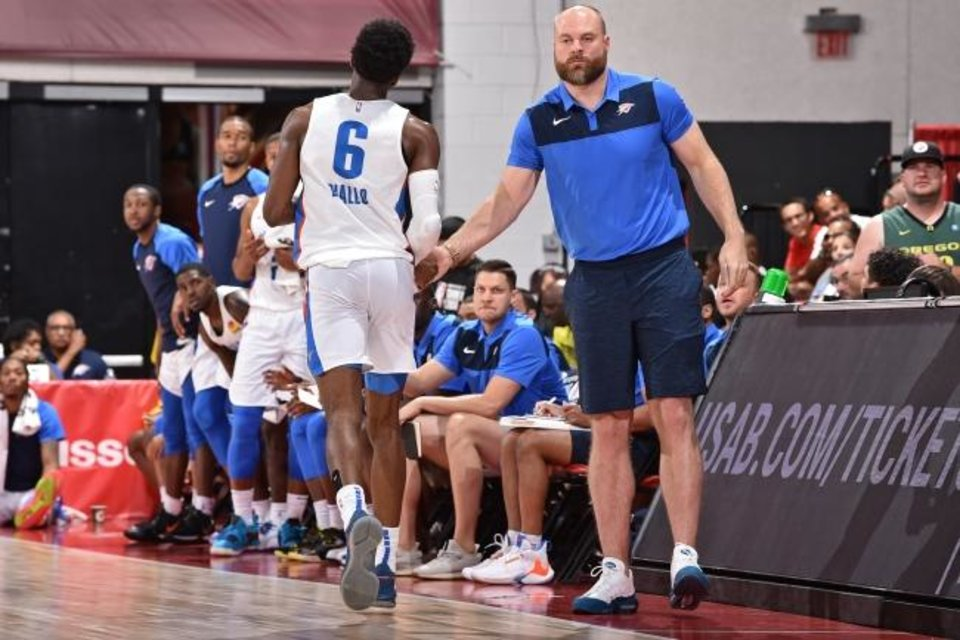 Photo -  Hamidou Diallo (6) greets coach Dave Bliss during a Thunder summer league game against the Trail Blazers on July 11 in Las Vegas. [David Dow/NBAE via Getty Images]