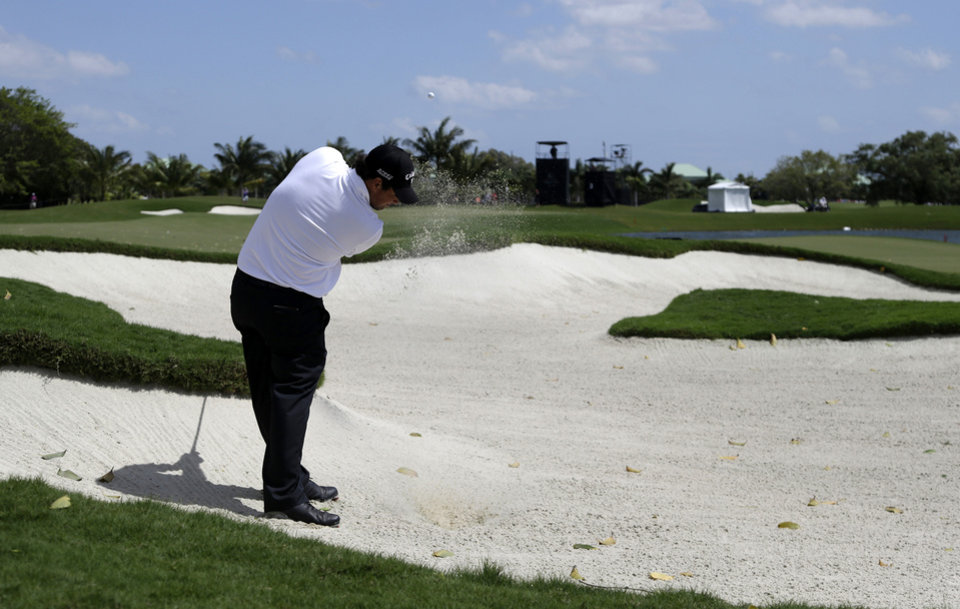 Photo - Patrick Reed hits from a third hole sand trap during the second round of the Cadillac Championship golf tournament on Friday, March 7, 2014, in Doral, Fla. (AP Photo/Lynne Sladky)