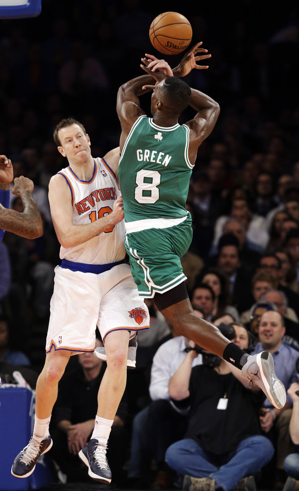 Photo - New York Knicks forward Steve Novak (16) blocks a shot by Boston Celtics forward Jeff Green (8) in the first half of their NBA basketball game at Madison Square Garden in New York, Monday, Jan. 7, 2013. (AP Photo/Kathy Willens)