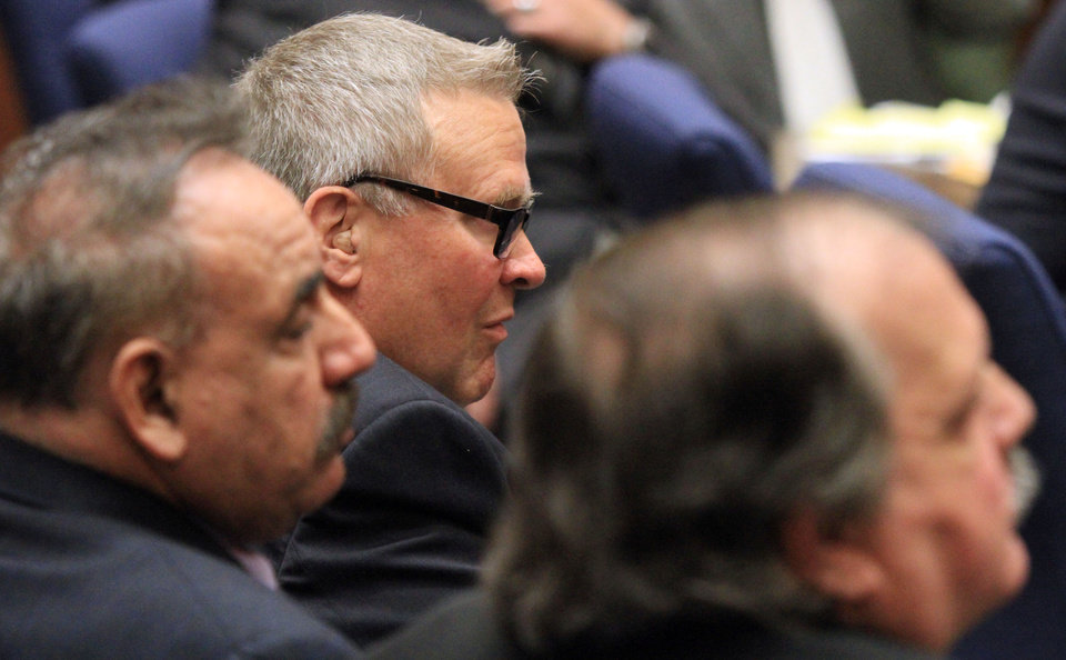 George Cole, center,a former Bell City Council member listens to the judge as a guilty verdict is read in his trial on Wednesday, March 20, 2013, in Los Angeles.  Cole and four former elected officials were convicted of multiple counts of misappropriation of public funds, and a sixth defendant was cleared entirely. Former Mayor Oscar Hernandez and co-defendants Cole, Teresa Jacobo, George Mirabal,  and Victor Belo were all convicted of multiple counts and acquitted of others.  The charges against them involved paying themselves inflated salaries of up to $100,000 a year in the city of 36,000 people, where one in four residents live below the poverty line.   (AP Photo/Los Angeles Times, Irfan Khan, Pool)