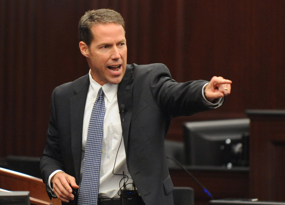 Photo - Assistant State Attorney John Guy delivers the rebuttal to the defense closing arguments during the trial of Michael Dunn in Jacksonville, Fla., Wednesday Feb. 12, 2014. Michael Dunn is charged in the shooting death of Jordan Davis in November 2012.(AP Photo/The Florida Times-Union, Bob Mack, Pool)