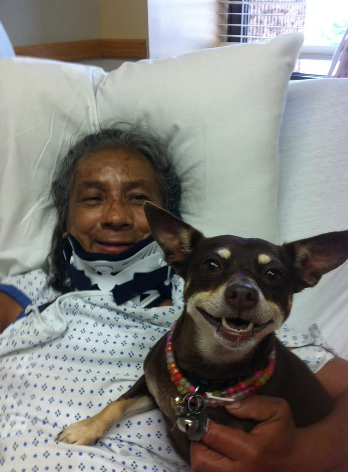 Photo - At OU Trauma Center, Ida Hernandez is reunited with her dog Bella, who had been displaced after Hernandez was injured in May 19 tornadoes in Shawnee. Photo provided.