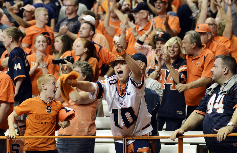 Photo - Syracuse fans celebrate after Syracuse's Kendall Moore caught a pass in the second overtime to give Syracuse a 27-26 win over Villanova in an NCAA college football game Friday, Aug. 29, 2014, in Syracuse, N.Y. (AP Photo/Heather Ainsworth)