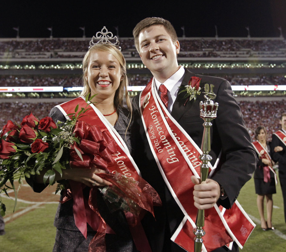 Photo - Michael Nash and Morgan Wolber receive their crowns as Homecoming King and Queen during halftime of the college football game between the University of Oklahoma Sooners (OU) and the Iowa State Cyclones (ISU) at the Glaylord Family-Oklahoma Memorial Stadium on Saturday, Oct. 16, 2010, in Norman, Okla.  Photo by Steve Sisney, The Oklahoman