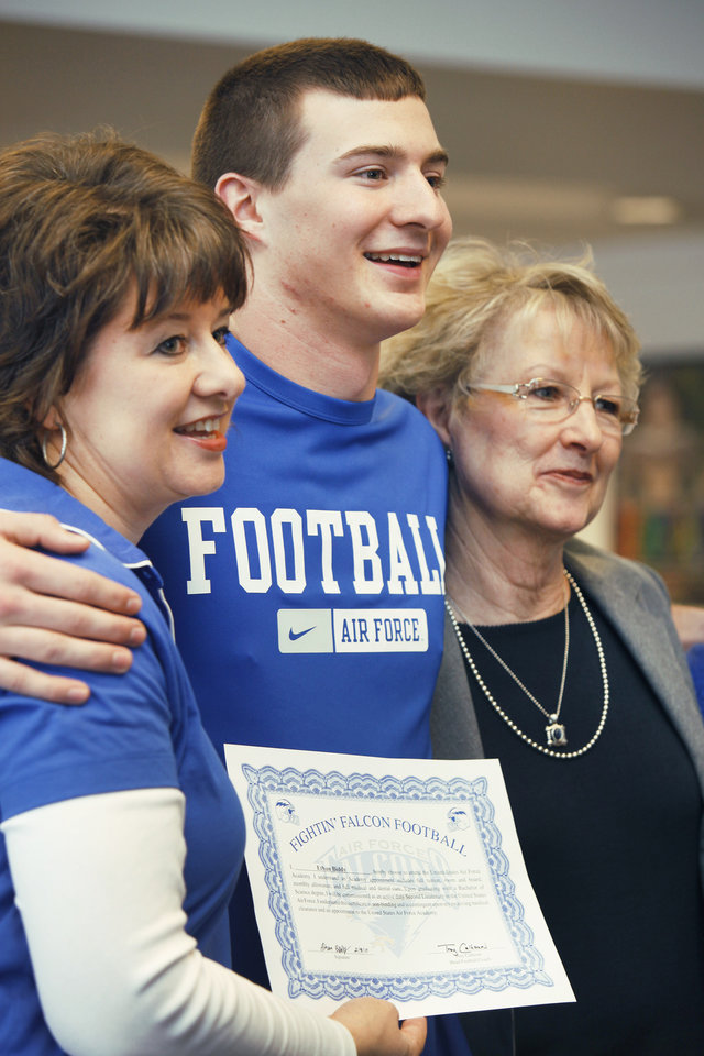 Tuttle's Ethan Biddy, who signed with Air Force, poses with his mom Jeannean, left, and grandmother Jessie Taylor, right, on Wednesday. Photo by Jaconna Aguirre, The Oklahoman