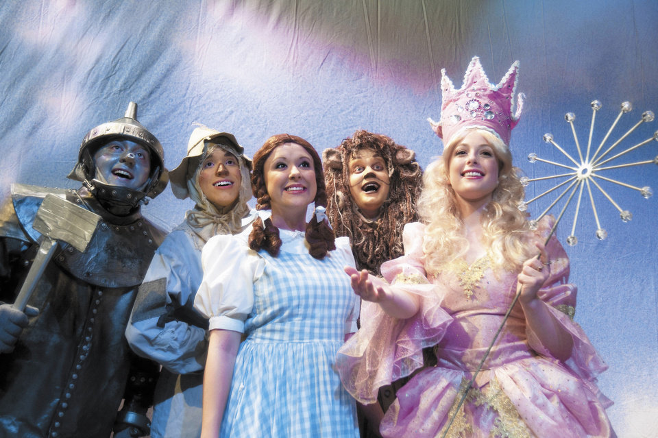 Actors who portray the Tin Man, Scarecrow, Dorothy, the Cowardly Lion and the Good Witch practice during the dress rehearsal for the Rose State College production of �The Wizard of Oz.� Photo provided by Rose State College