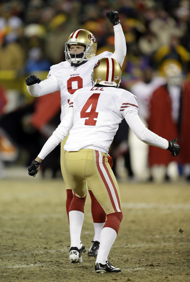 Photo - San Francisco 49ers kicker Phil Dawson (9) celebrates after kicking the game-winning field goal during the second half of an NFL wild-card playoff football game, Sunday, Jan. 5, 2014, in Green Bay, Wis. The 49ers won 23-20. (AP Photo/Mike Roemer)