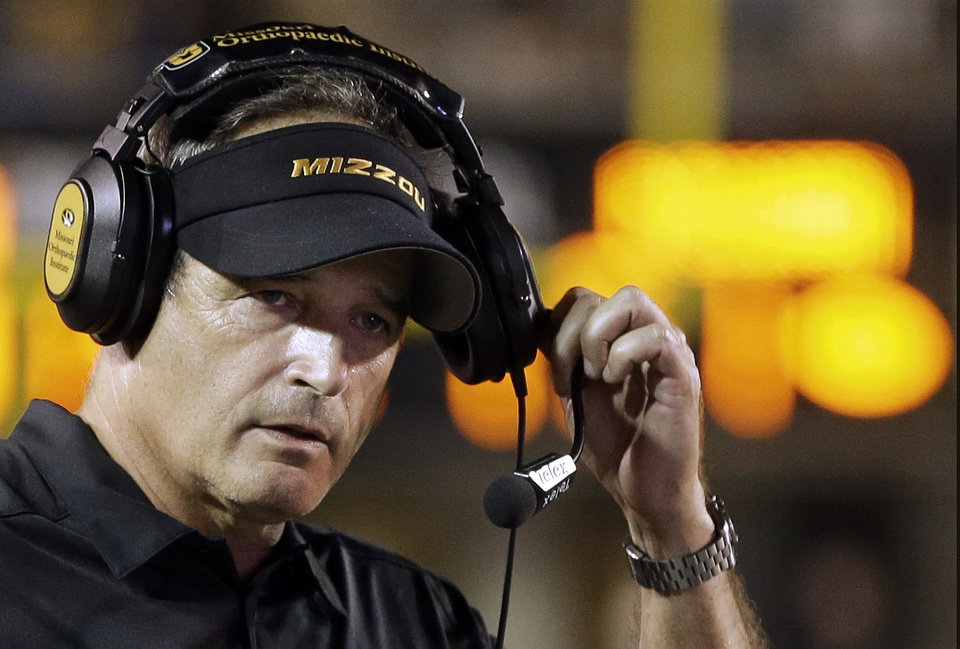 Missouri coach Gary Pinkel watches during the fourth quarter of an NCAA college football game against Vanderbilt on Saturday, Oct. 5, 2013, in Nashville, Tenn. Missouri won 51-28. (AP Photo/Mark Humphrey)