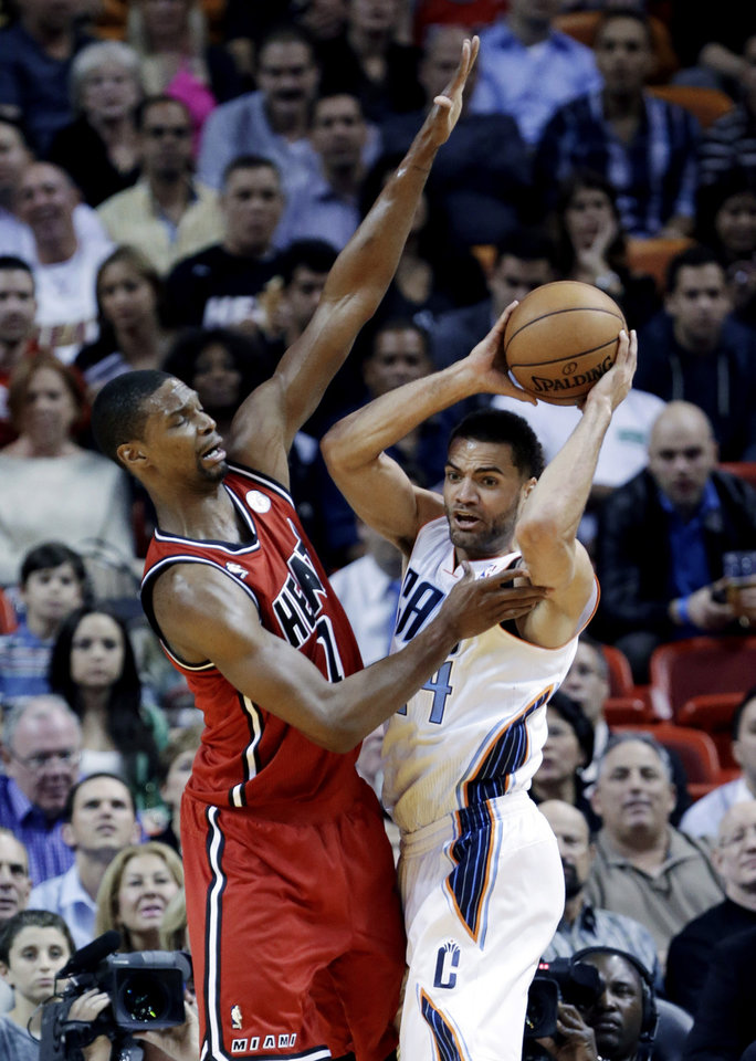 Photo - Charlotte Bobcats guard Jeffery Taylor (44) of Sweden, looks for an open teammate past Miami Heat center Chris Bosh (1) during the first half of an NBA basketball game, Monday, Feb. 4, 2013 in Miami. (AP Photo/Wilfredo Lee)