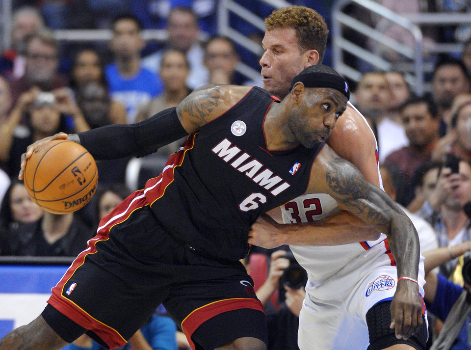 Miami Heat forward LeBron James (6) drives past Los Angeles Clippers forward Blake Griffin during the first half of their NBA basketball game, Wednesday, Nov. 14, 2012, in Los Angeles. (AP Photo/Mark J. Terrill)