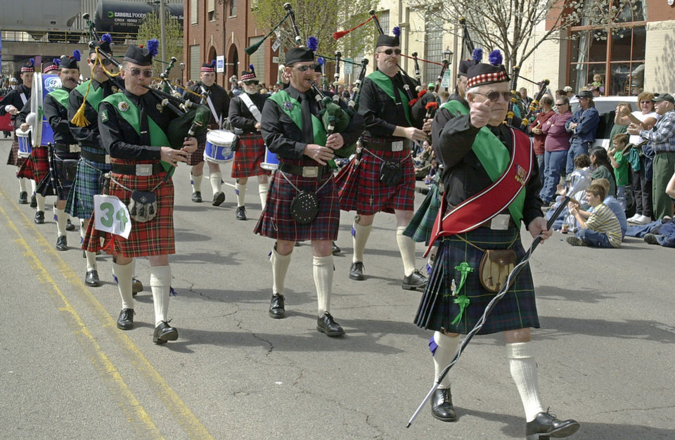 Members of Oklahoma Scottish Pipes and Drums march down Sheridan Avenue in Bricktown during the 2001 St. Patrick's Day parade in Bricktown.  Photo by Nate Billings, The Oklahoman Archives <strong>NATE BILLINGS</strong>