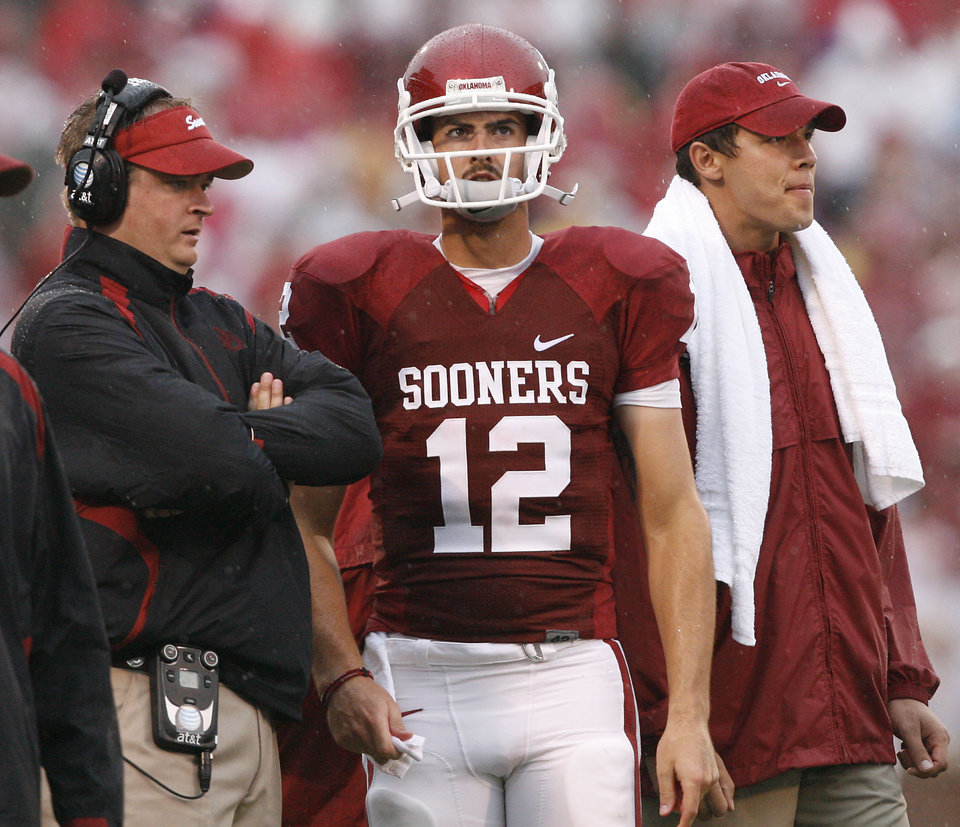 Photo - Oklahoma's Josh Heupel, Landry Jones and Sam Bradford look on from the sideline during the first half of the college football game between The University of Oklahoma Sooners (OU) and Idaho State University Bengals (ISU) at the Gaylord Family -- Oklahoma Memorial Stadium on Saturday, Sept. 12, 2009, in Norman, Okla.   Photo by Chris Landsberger, The Oklahoman. ORG XMIT: KOD