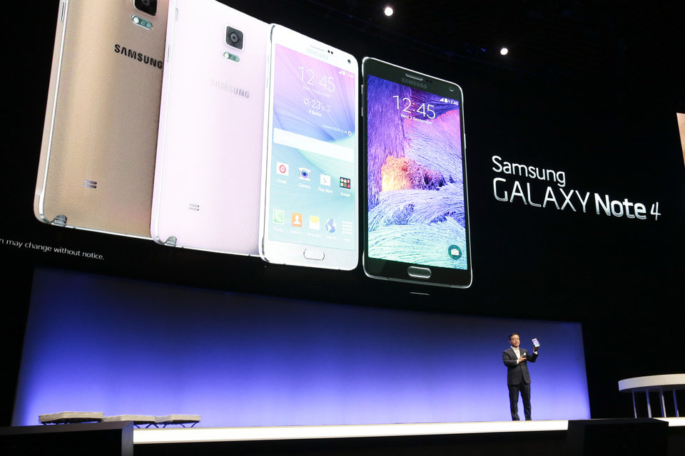 Photo - DJ Lee, Executive Vice President of Samsung,  presents a Samsung Galaxy Note 4 during his keynote at an unpacked event of Samsung ahead oh the consumer electronic fair IFA in Berlin, Wednesday, Sept. 3, 2014. (AP Photo/Markus Schreiber)