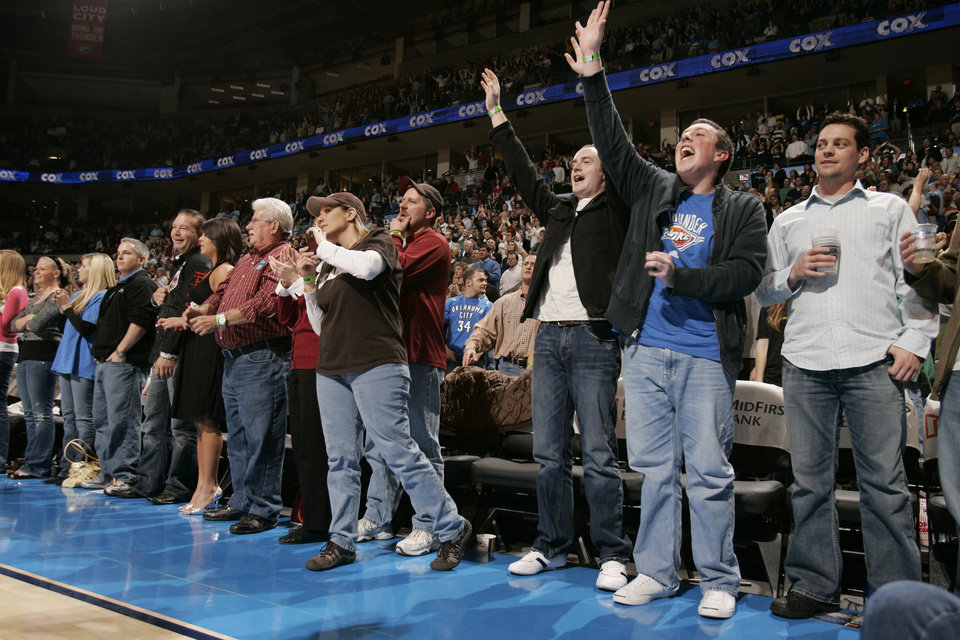 Photo - Fans react as the Thunder ties the score late in the second half as the Oklahoma City Thunder plays the Houston Rockets at the Ford Center in Oklahoma City, Okla. on Friday, January 9, 2009. 