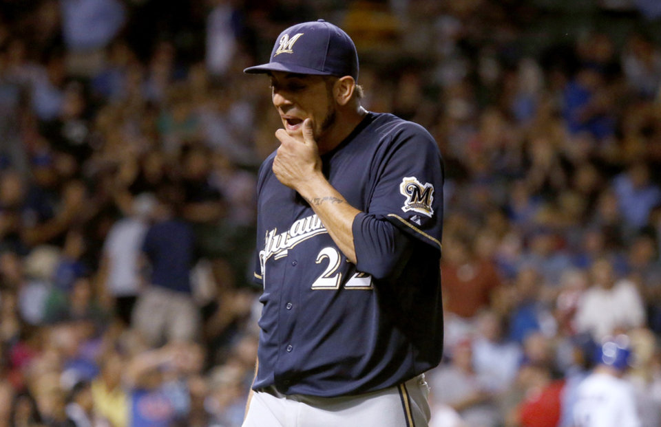 Photo - Milwaukee Brewers starting pitcher Matt Garza walks to the dugout after the third inning of a baseball game against the Chicago Cubs, Wednesday, Sept. 3, 2014, in Chicago. (AP Photo/Charles Rex Arbogast)