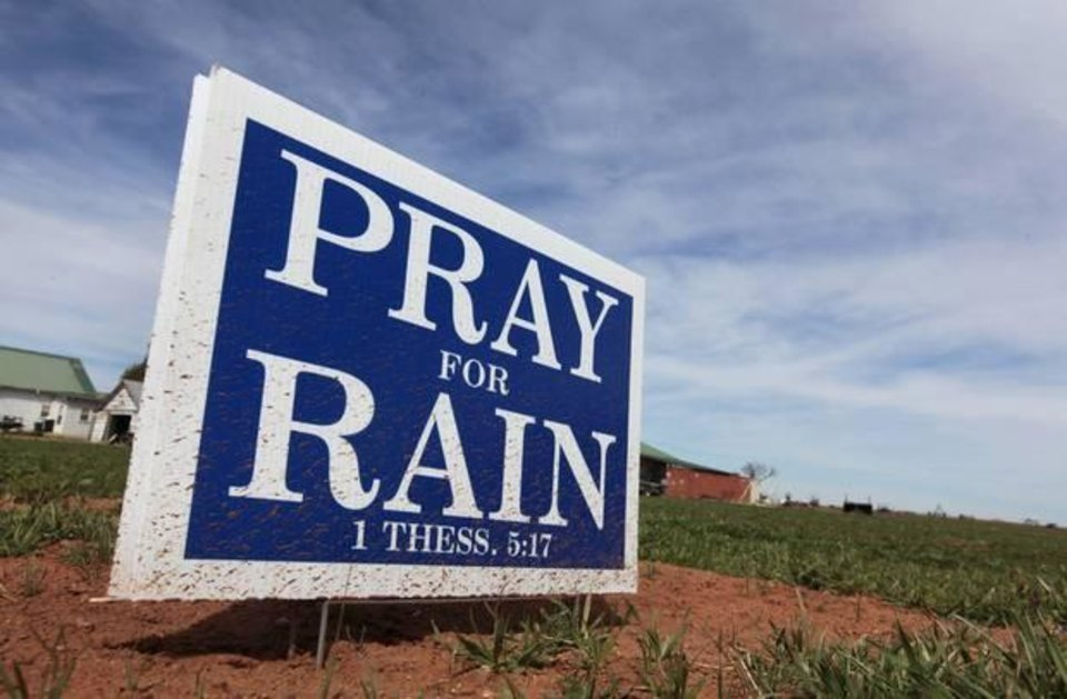 Photo - Pray for rain sign on the main street of Elmer, for drought story, Monday, March 17, 2014. Photo by David McDaniel, The Oklahoman
