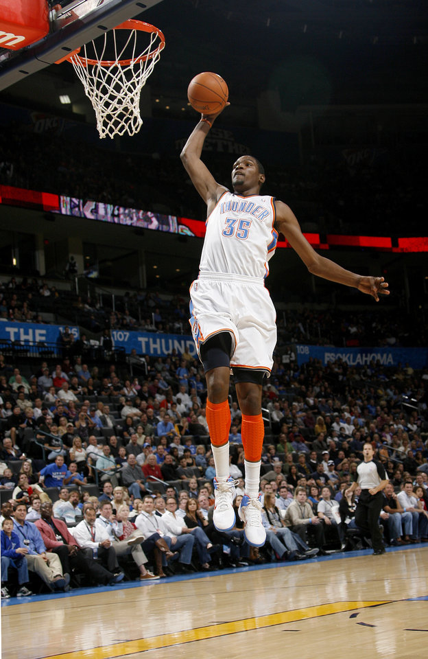 Photo - Oklahoma City's Kevin Durant (35) goes up for dunk during the preseason NBA basketball game between the Oklahoma City Thunder an CSKA Moscow in Oklahoma City, Thursday, October 14, 2010. Photo by Bryan Terry, The Oklahoman