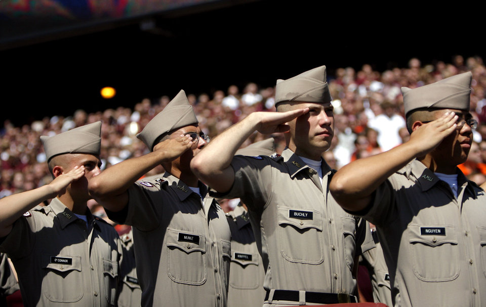 Photo - Texas A&M Corps of Cadets salutes during the first half of OSU's 30-29 win on Saturday in College Station, Texas. Photo by Sarah Phipps, The Oklahoman