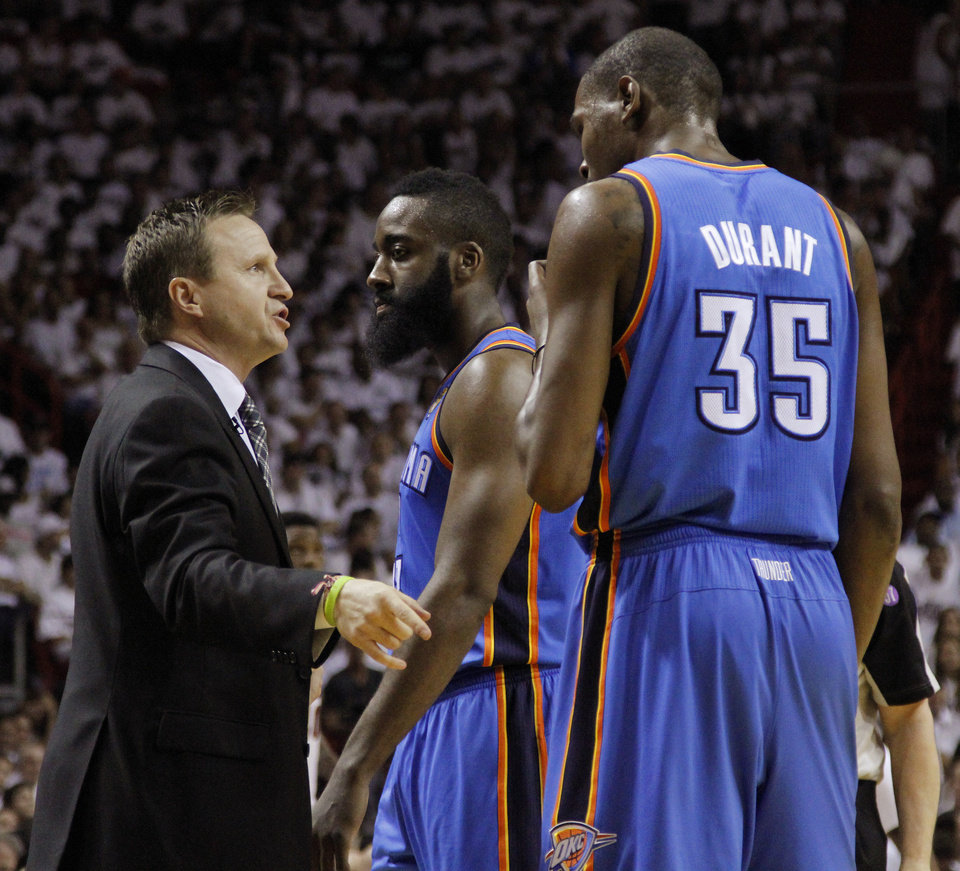 Oklahoma City coach Scott Brooks talks with Oklahoma City\'s James Harden, center, and Oklahoma City\'s Kevin Durant during Game 3 of the NBA Finals between the Oklahoma City Thunder and the Miami Heat at American Airlines Arena, Sunday, June 17, 2012. Photo by Bryan Terry, The Oklahoman