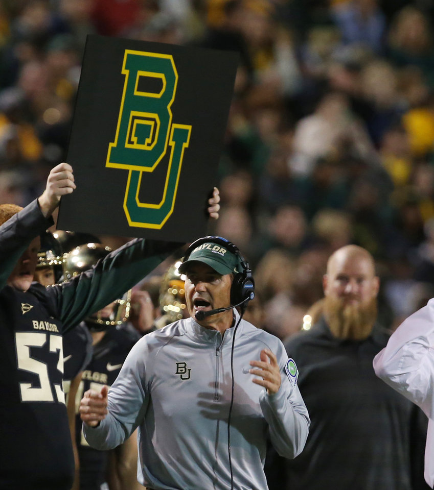 Photo - Baylor head football coach Art Briles checks on a play against West Virginia during the first half of an NCAA college football game on Saturday, Oct.  5, 2013, in Waco, Texas. (AP Photo/Rod Aydelotte)