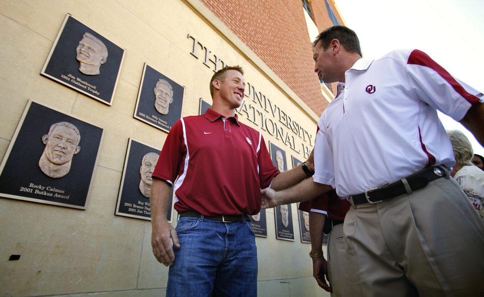Photo - Head football coach Bob Stoops talks with Rocky Calums after the unveiling of the National Honors display before the college football game between the University of Oklahoma Sooners (OU) and Utah State University Aggies (USU) at the Gaylord Family-Oklahoma Memorial Stadium on Saturday, Sept. 4, 2010, in Norman, Okla.   Photo by Steve Sisney, The Oklahoman