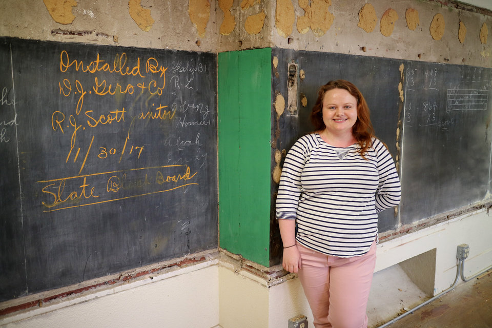 Photo - Cinthea Comer, 10th grade English teacher stands next to blackboards discovered in her room. Renovation at Emerson School revealed the original blackboards with lessons  from 1917 still intact.  Friday, June 5, 2015. Photo by Doug Hoke, The Oklahoman