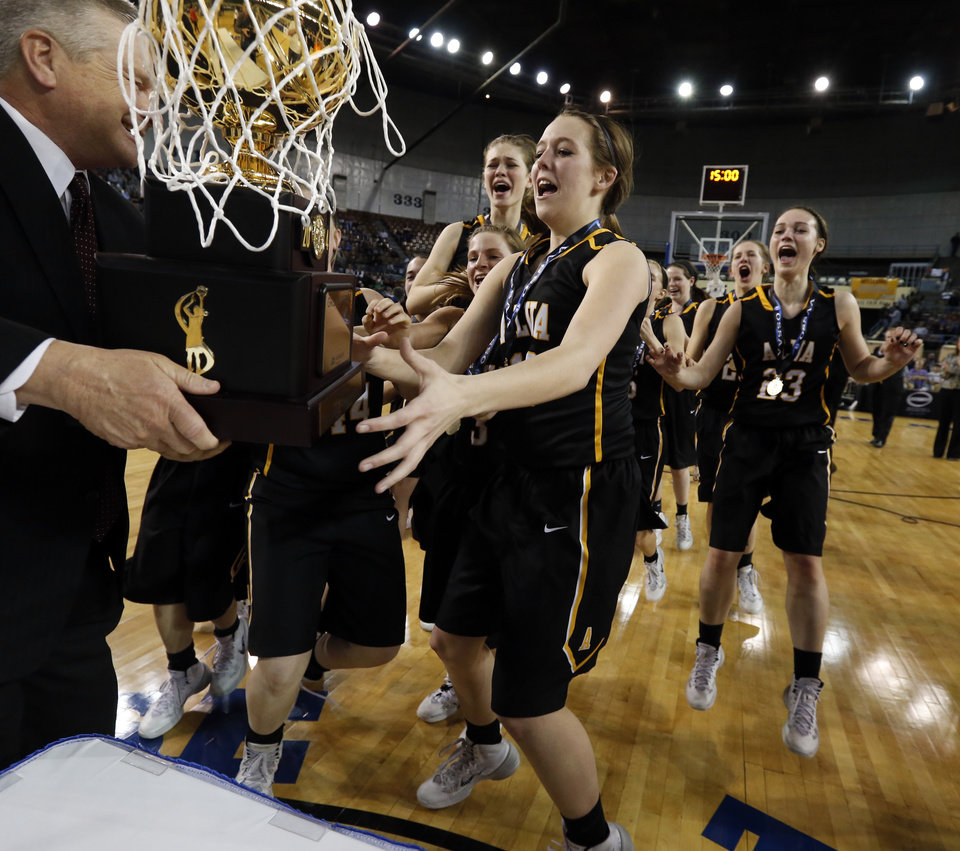 Photo - Alva players receive the championship gold ball after defeating Adair 49-40 in the finals of the State Class 3A Girls Basketball Tournament at the Fairgrounds Arena on Saturday, March 15, 2014, in Oklahoma City, Okla. Photo by Steve Sisney, The Oklahoman