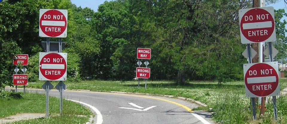 "This undated handout photo provided by the New York State Department of Transportation shows double-posted ""Do Not Enter"" and ""Wrong Way"" signs on an exit ramp. Hundreds of people are killed each a year when drivers turn the wrong-way into the face of oncoming traffic on high-speed highways, and a majority of the crashes involves drivers with blood alcohol levels more than twice the legal limit, a federal accident researcher said Tuesday. (AP Photo/New York State Department of Transportation )"