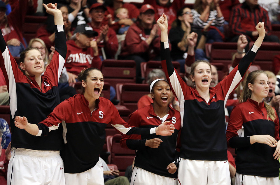 Photo - Stanford players on the bench celebrate a score against Oregon State during the second half of an NCAA college basketball game Sunday, Jan. 5, 2014, in Stanford, Calif. (AP Photo/Ben Margot)
