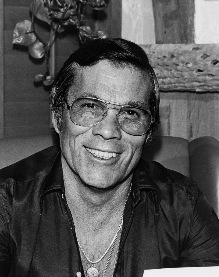 Photo - FILE - This 1983 publicity file photo provided by courtesy AMPAS shows stuntman, Hal Needham.  Needham, D.A. Pennebaker, George Stevens, Jr., and Jeffrey Katzenberg will accept their Oscar statuettes at the 4th annual Governors Awards from the Academy of Motion Picture Arts and Sciences' Board of Governors at a private ceremony Saturday, Dec. 1, 2012, at the Hollywood and Highland Center, in Los Angeles. (AP Photo/AMPAS)
