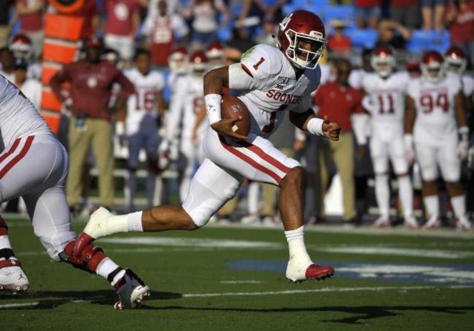Photo -  Oklahoma quarterback Jalen Hurts runs for a touchdown during the Sooners' win over UCLA Saturday in Pasadena, Calif. Hurts rushed for 150 yards and the touchdown in the game. [AP PHOTO]