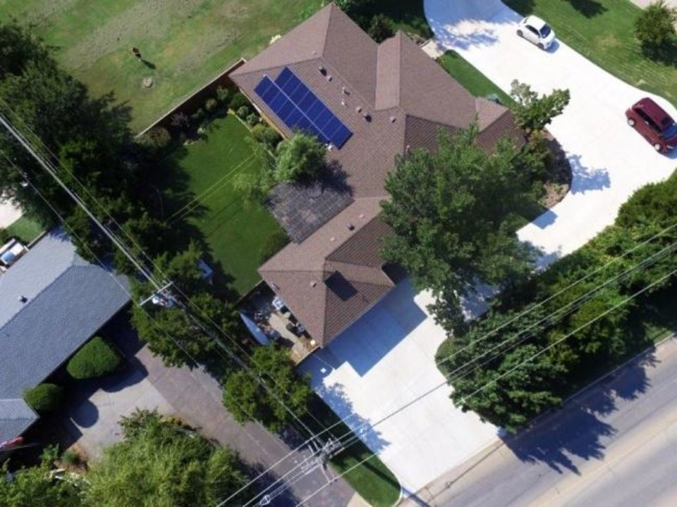 Photo -  Roof pitches, angles toward the sun and shade factors all play in to how solar systems are installed on homes and businesses. This system was installed on a home in Nichols Hills. [PROVIDED BY SOLAR POWER OF OKLAHOMA]