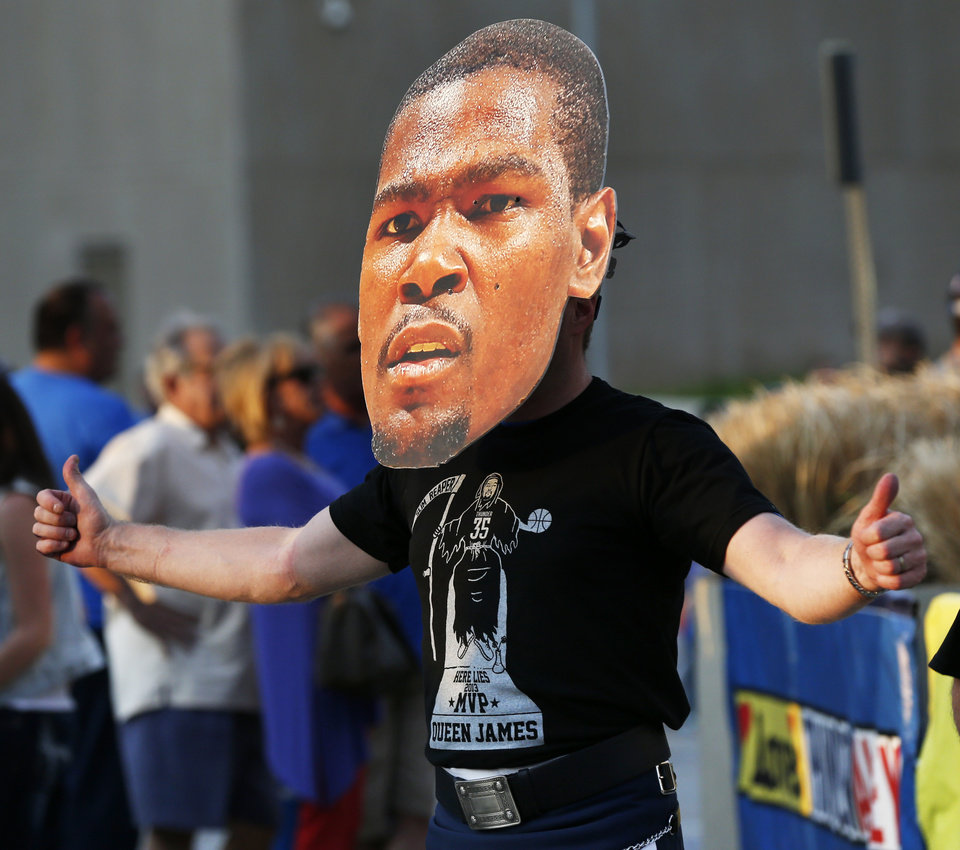 Photo - Gary Mawer, of Oklahoma City, wears a Kevin Durant mask in Thunder Alley before Game 1 in the first round of the NBA playoffs between the Oklahoma City Thunder and the Memphis Grizzlies at Chesapeake Energy Arena in Oklahoma City, Saturday, April 19, 2014. Photo by Nate Billings, The Oklahoman