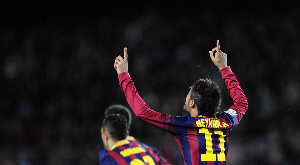 Photo - FC Barcelona's Neymar from Brazil, reacts after scoring against Celta Vigo during a Spanish La Liga soccer match at the Camp Nou stadium in Barcelona, Spain, Wednesday, March 26, 2014. (AP Photo/Manu Fernandez)