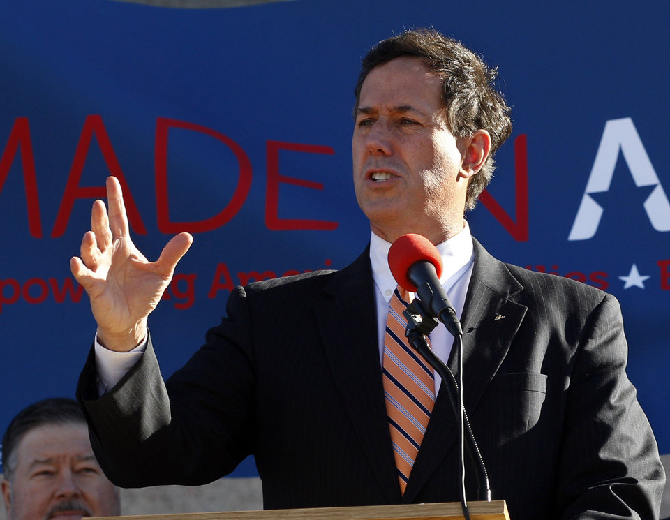 Republican presidential candidate, former Pennsylvania Sen. Rick Santorum, gestures as he speaks at a rally in Oklahoma City, Sunday, March 4, 2012. (AP Photo/Sue Ogrocki) ORG XMIT: OKSO104