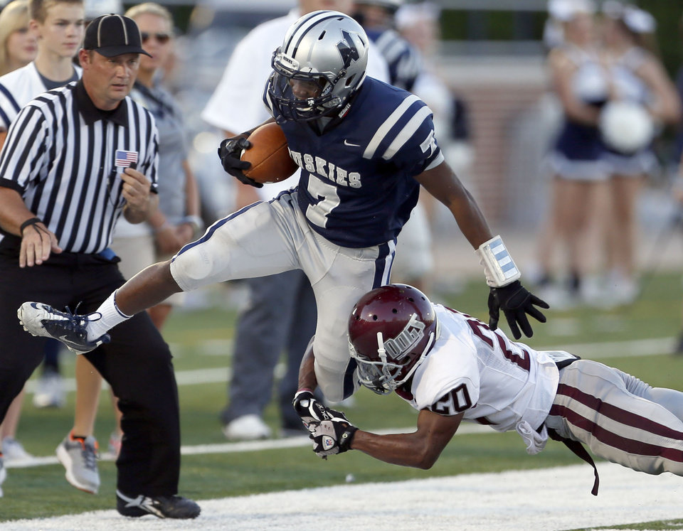 Photo - Edmond North's Marque Depp tries to get by Edmond Memorial's Tyren lawson during the high school football game between Edmond North and Edmond Memorial at Wantland Stadium in Edmond, Okla., Friday, Aug. 31, 2012. Photo by Sarah Phipps, The Oklahoman