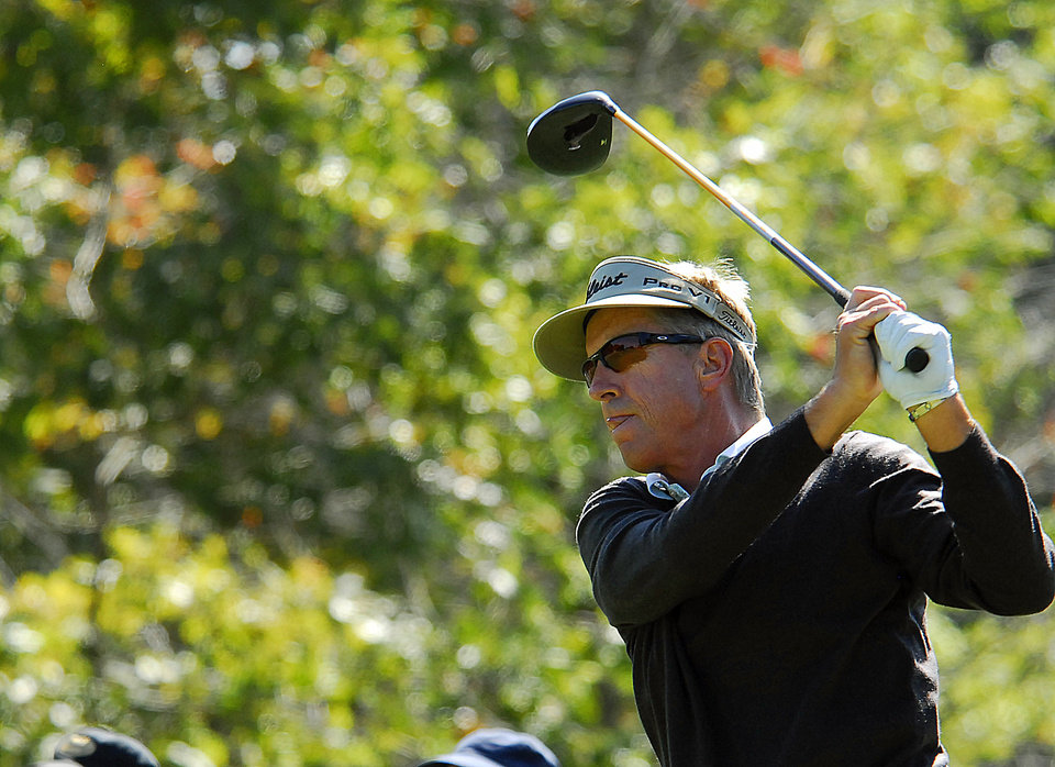 Photo -   Dan Forsman watches his shot after teeing off on the seventh hole during the second round of the Greater Hickory Classic Champions Tour golf tournament at Rock Barn in Conover, N.C., Saturday, Oct. 13, 2012 (AP Photo/Robert Reed)