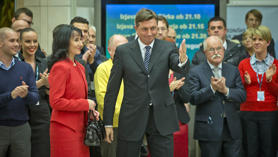 Photo - President elect, Slovenia's former prime minister Borut Pahor poses with his team to the media in Ljubljana, Slovenia, Sunday, Dec. 2, 2012.  Pahor, who has called for unity in the tiny EU nation amid growing discontent with government tax hikes and spending cuts, won the presidential election. (AP Photo/Darko Bandic)