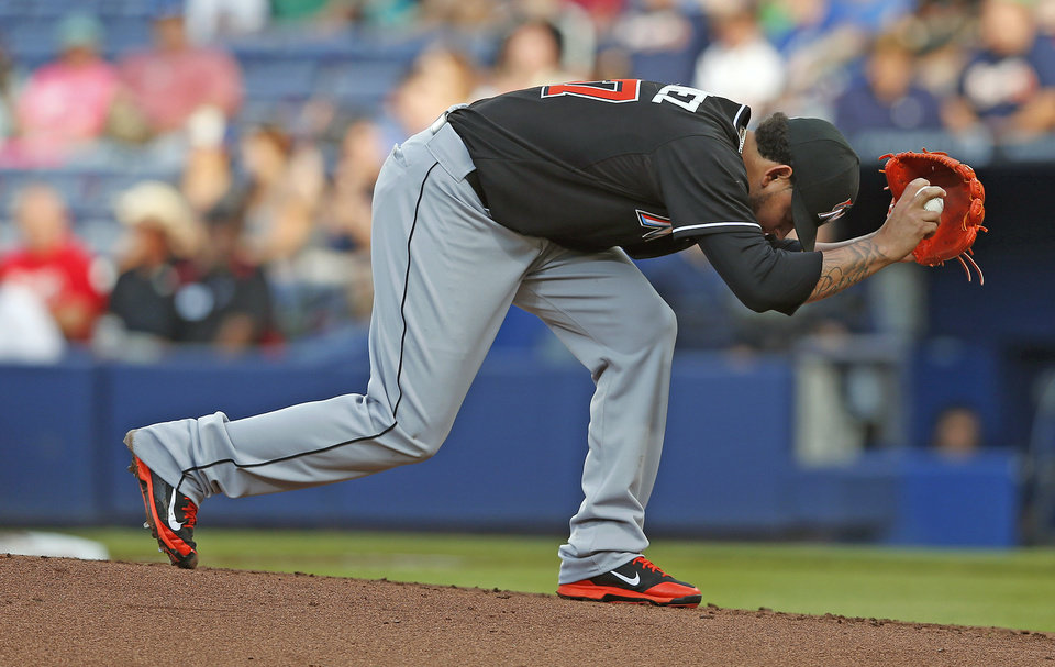 Photo - Miami Marlins starter Henderson Alvarez winds up before throwing the first pitch in the first inning of a baseball game against the Atlanta Braves, Thursday, July 24, 2014, in Atlanta. (AP Photo)