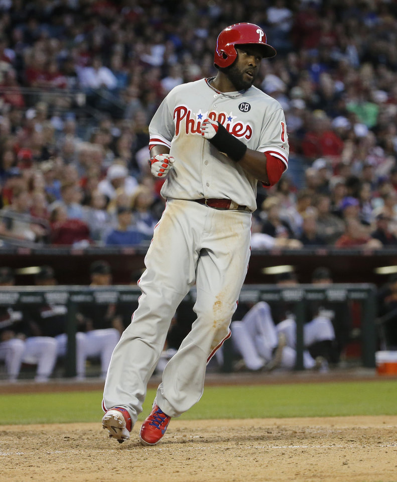 Philadelphia Phillies\' Tony Gywnn Jr. scores on a ground out by Jimmy Rollins during the seventh inning of a baseball game against the Arizona Diamondbacks on Saturday, April 26, 2014, in Phoenix. (AP Photo/Matt York)