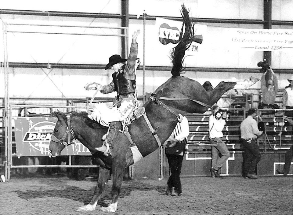 Jet McCoy competes in saddle bronc riding at a rodeo in Ada in 1999.