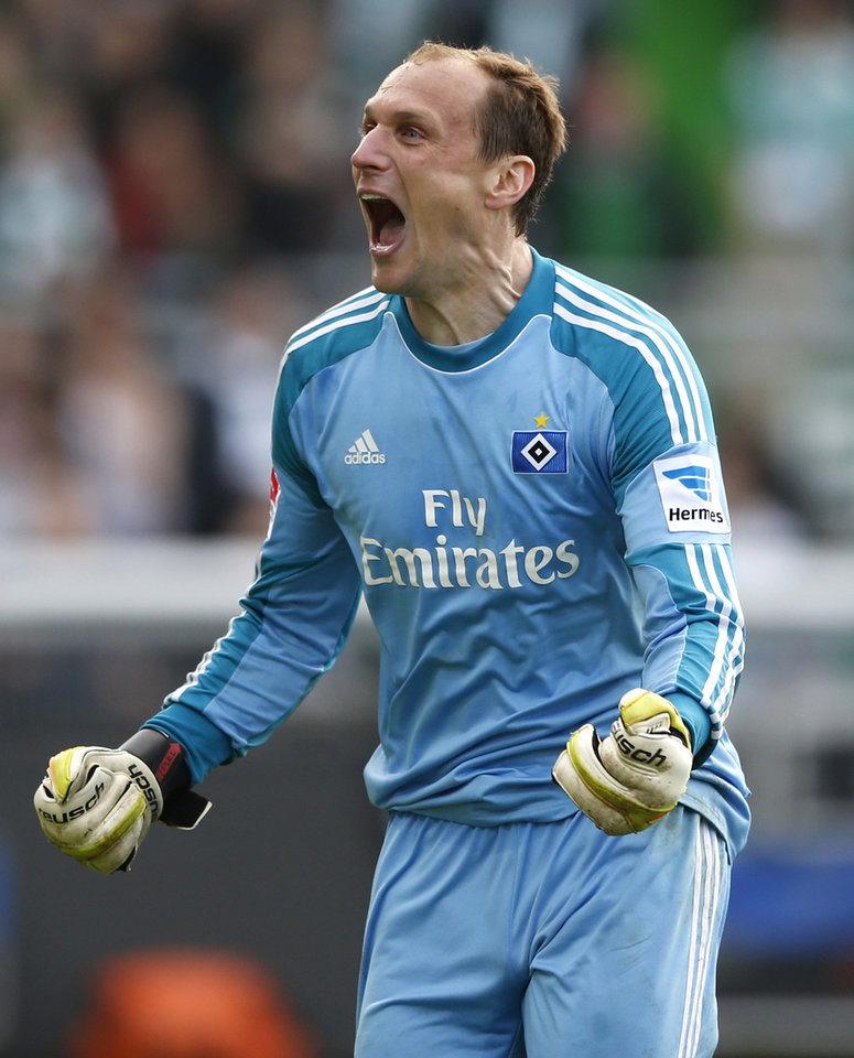 Photo - Hamburg goalkeeper Jaroslav Drobny of Czech Republic celebrates after winning  relegation  play-offs  between Greuther Fuerth and Hamburger SV in Fuerth, Germany, Sunday, May 18, 2014. Hamburg played 1-1 in Fuerth and remains in the first division .   (AP Photo/Matthias Schrader)