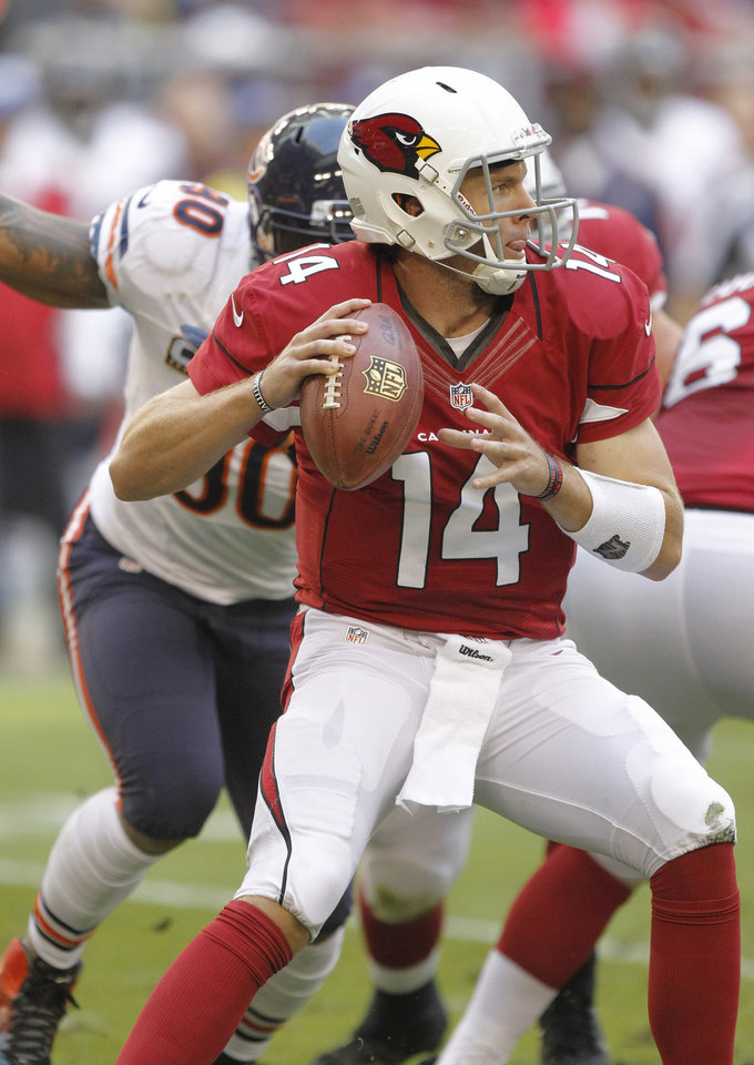 Photo - Arizona Cardinals quarterback Ryan Lindley (14) looks to pass against the Chicago Bears during the first half of an NFL football game, Sunday, Dec. 23, 2012, in Glendale, Ariz. (AP Photo/Paul Connors)