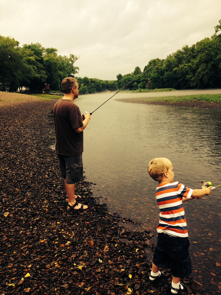 Dad and son fishing on Lake Tenkiller, Gore, OK - Photo by Carole Weaver